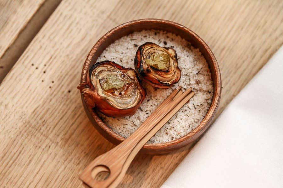 Fried onion on a bed of sea salt.