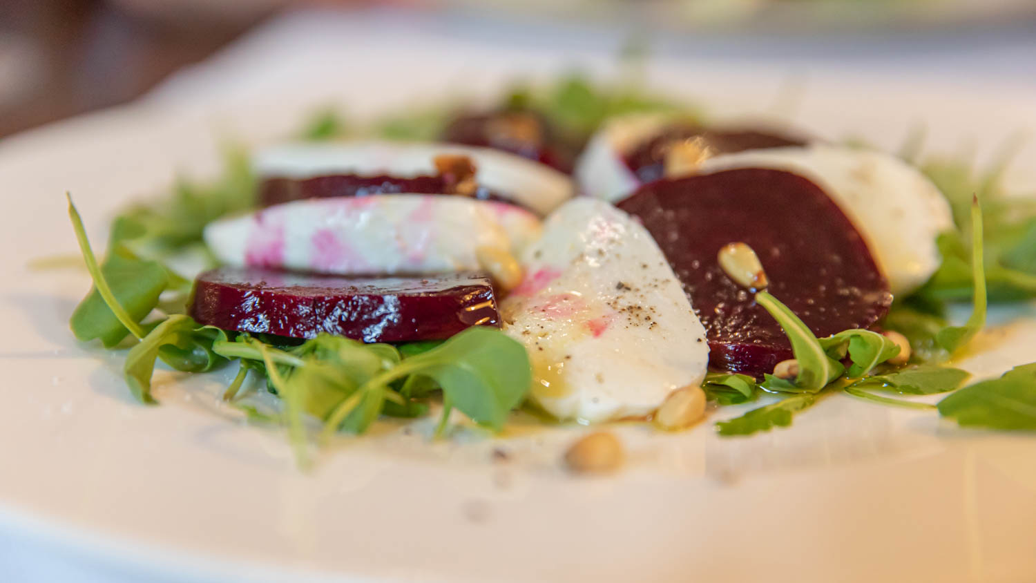 Beetroot salad with cheese and pine nuts