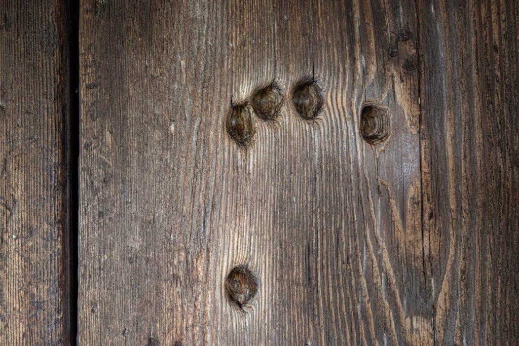 Holes in the door in Ornässtugan